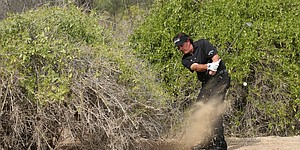 PHOTOS: Phil Mickelson's right-handed shot