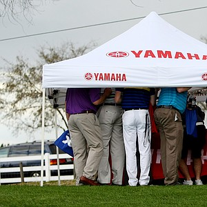 People took cover under a Yahama tent during some rain at the PGA Show Demo Day at Orange County National.