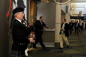 Reginald Lyle plays the bagpipes at the entrance of the media area during the 2014 PGA Merchandise Show at the Orange County Convention Center.