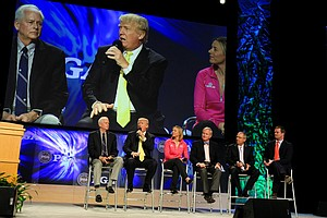 Donald Trump is shown on the big screen during the State of the Industry Panel Discussion at the 2014 PGA Merchandise Show at the Orange County Convention Center.