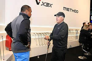 Amhad Rashad gets a putting lesson from Dave Stockton at the Nike booth during the 2014 PGA Merchandise Show at the Orange County Convention Center.
