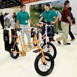 Todd May and Geoff Slater of Higher Ground Golf Company stand with The Golf Bike at the 2014 PGA Merchandise Show at the Orange County Convention Center.