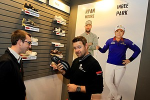 Ryan Moore shows off some of the new shoes at the True Linkswear booth during the 2014 PGA Merchandise Show. Inbee Park is now wearing the shoes.