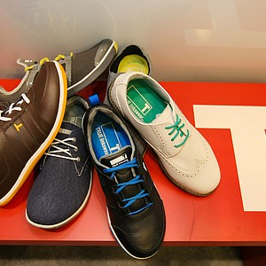The 2014 line-up of TRUE Linkswear's shoes at the PGA Merchandise Show at the Orange County Convention Center.