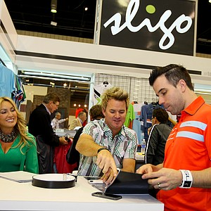 PGA Tour's Brian Gay, center, and wife, Kimberly, talk with Aaron Nudds, director of Sligo, during the 2014 PGA Merchandise Show at the Orange County Convention Center.