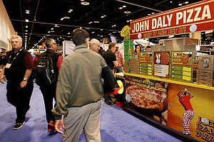 "John Daly Pizza ""Grip It and Eat It"" at the 2014 PGA Merchandise Show at the Orange County Convention Center."