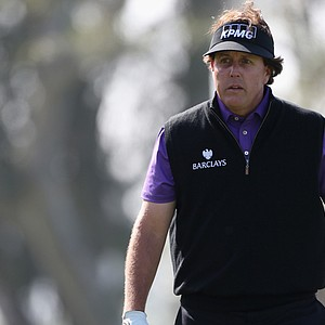 Phil Mickelson dealt with muscle pain in his lower back at the Farmers Insurance Open. He withdrew from the event on Friday night.