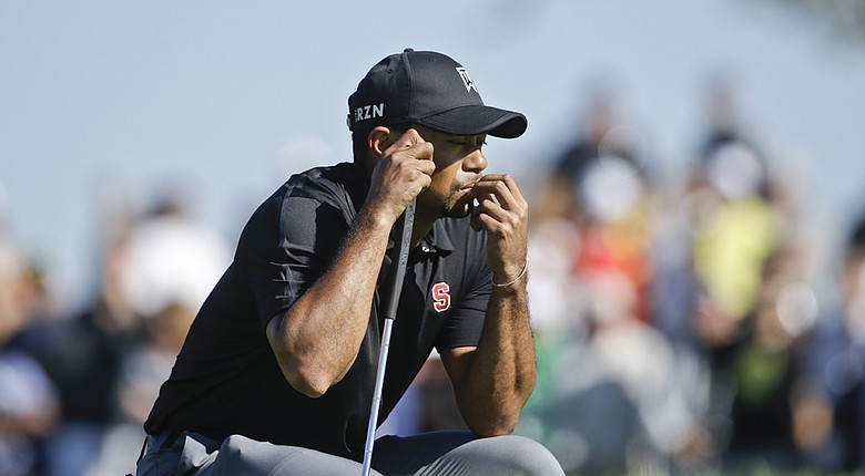 Tiger Woods is headed to the Dubai Desert Classic to play alongside Rory McIlroy in the first two rounds; he missed the third-round cut at the Farmers Insurance Open (shown here).