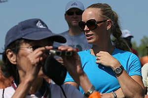 Rory McIlroy's fiance Caroline Wozniacki watches McIlroy during the first round of the Omega Dubai Desert Classic.
