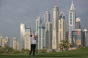 Stephen Gallacher follows his ball on the 13th hole during the first round of the Omega Dubai Desert Classic.