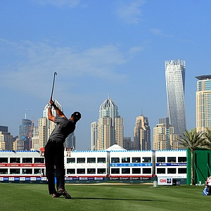 Tiger Woods follows through a shot on the 18th hole during the first round of the Omega Dubai Desert Classic.