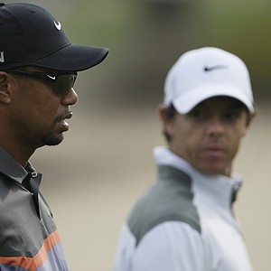 Tiger Woods (68) and Rory McIlroy (63) combined for 11 birdies and an eagle on Thursday at the Omega Dubai Desert Classic.