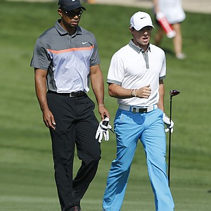 Tiger Woods and Rory McIlroy talk during the first round of the Omega Dubai Desert Classic.