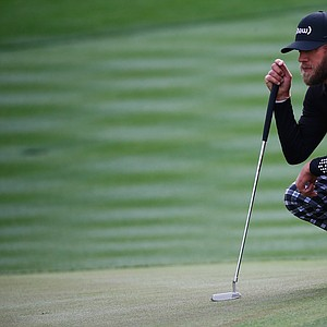 Graham DeLaet looks over a putt on the seventh hole during the second round of the Waste Management Phoenix Open.