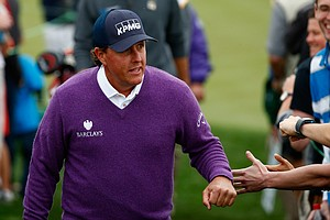 Phil Mickelson acknowledges the crowd during the second round of the Waste Management Phoenix Open.