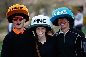 Fans pose with PING hats in support of Hunter Mahan during the second round of the Waste Management Phoenix Open at TPC Scottsdale.
