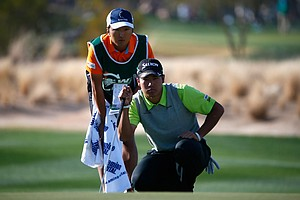 Hideki Matsuyama looks over a putt on the 17th hole during the third round of the Waste Management Phoenix Open at TPC Scottsdale.