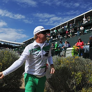 Brian Gay throws merchandise to fans on the 16th hole during the third round of the 2014 Waste Management Phoenix Open.