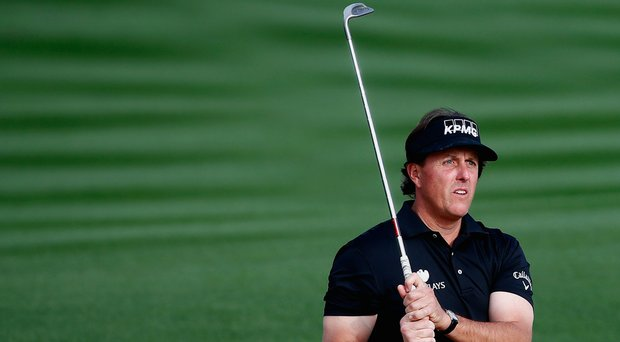 Phil Mickelson plays a shot on the second hole during the third round of the Waste Management Phoenix Open.