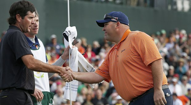 Kevin Stadler shakes hands after winning the 2014 Phoenix Open by a shot over Bubba Watson (left) and Graham DeLaet for his first PGA Tour win.