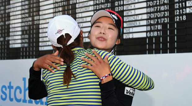 Mi Hyang Lee receives a congratulatory hug from Lydia Ko after the South Korean won the 2014 New Zealand Open.