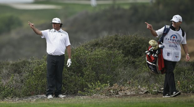 Pat Perez and caddie Mike Hartford during the PGA Tour's 2014 Farmers Insurance Open.