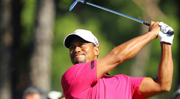Tiger Woods flexes his muscle during a follow through at the 2013 Turkish Open.