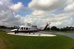 Donald Trump's helicopter sits adjacent to the ninth tee at Doral.