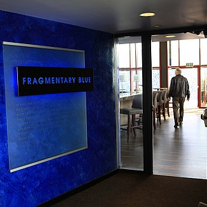 Fragmentary Blue is the rooftop bar at the lodge at Streamsong. The entrance is adorned with the Robert Frost poem.