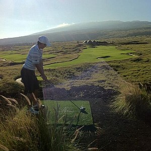 A University of Wasghinton golfer playing a round at the Nanea golf course in Hawaii.