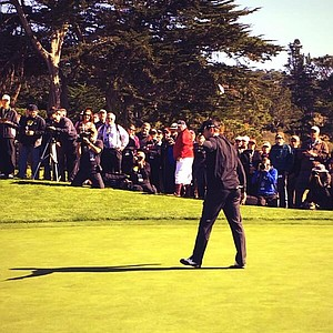 Aaron Rodgers sinks a putt for $20,000 for Team Rodgers-Romano charities on the eve of the 2014 AT&T Pebble Beach National Pro-Am.