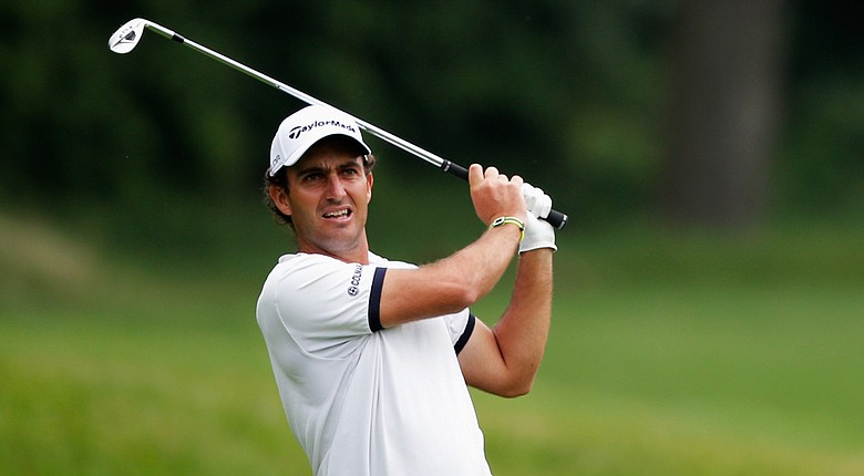 Edoardo Molinari hits his second shot on the sixth hole during the first round of the Joburg Open at Royal Johannesburg and Kensington Golf Club.