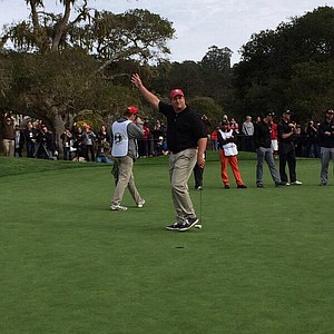Harris Barton of the NFL's San Francisco 49ers makes a putt to win $40,000 for charity prior to the AT&T Pebble Beach National Pro-Am.