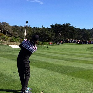 Musician Jake Owen hits an approach shot at No. 1 while readying for the AT&T Pebble Beach National Pro-Am.