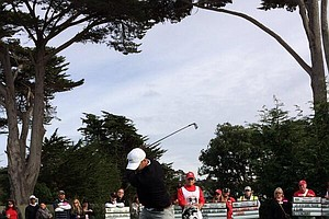 Quarterback Alex Smith of the NFL's Kansas City Chiefs tees off on the 17th hole at Pebble Beach.