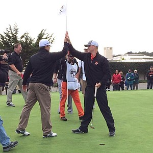 Matt Cain of Major League Baseball's San Francisco Giants putts for a $20,000 win for charity before the AT&T Pebble Beach National Pro-Am.