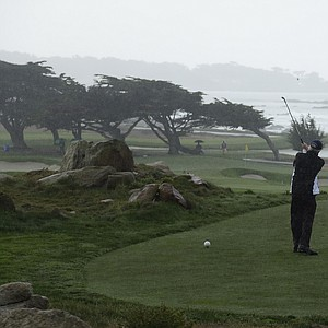 Businessman Charles Schwab during a wet first round of the PGA Tour's 2014 AT&T Pebble Beach National Pro-Am.