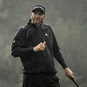 Dustin Johnson during a wet first round of the PGA Tour's 2014 AT&T Pebble Beach National Pro-Am.