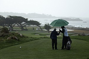 Businessman George Roberts during a rainy first round of the PGA Tour's 2014 AT&T Pebble Beach National Pro-Am.