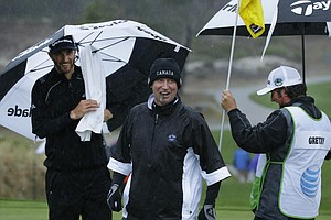 Dustin Johnson with his future father-in-law, NHL Hall of Famer Wayne Gretzky, during a rainy first round of the PGA Tour's 2014 AT&T Pebble Beach National Pro-Am.