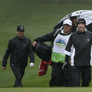 NHL Hall of Famer Wayne Gretzky and musician Kid Rock during a wet first round of the PGA Tour's 2014 AT&T Pebble Beach National Pro-Am.