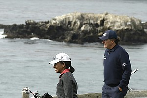 Political scientist and diplomat Condoleeza Rice with Phil Mickelson during the second round of the 2014 AT&T Pebble Beach National Pro-Am.