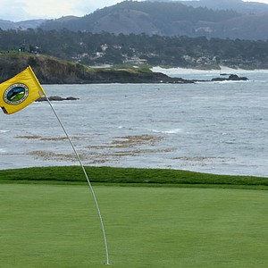 High winds bend the flagstick at the 18th hole Saturday at Pebble Beach Golf Links.