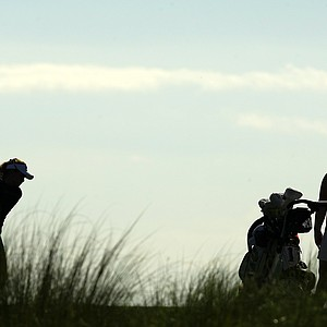 Players are silhouetted at No. 1 during the UCF Challenge at Eagle Creek Golf Club.