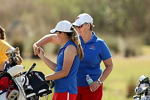 SMU head coach Jeanne Sutherland gives a fist bump to Lindsey  McCurdy during the UCF Challenge at Eagle Creek Golf Club.