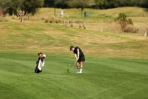 Ashley Holder of UCF hits from the fairway at No. 13 during the UCF Challenge at Eagle Creek Golf Club.