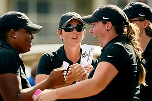 Emily Marron, UCF head coach, celebrates with her team during the UCF Challenge at Eagle Creek Golf Club.