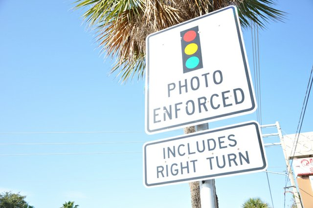 Lawsuits and a push to ban red light cameras have come at odds with a resolute Winter Park Commission, which is fighting to keep the cameras.