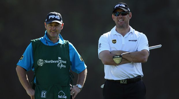 Lee Westwood (right) and caddie Billy Foster look on during a practice round for the Northern Trust Open.