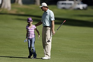 Ernie Els with a young fan during Wednesday's pro-am day at the PGA Tour's 2014 Northern Trust Open at Riviera CC near Los Angeles.